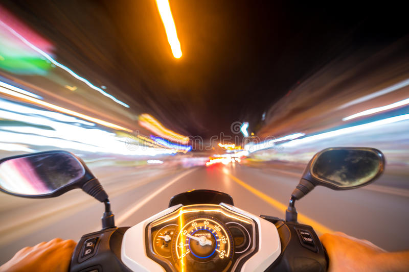 Night motorbike ride. Abstract speed motion background, night city motorbike ride, selective focus on speedometer stock images