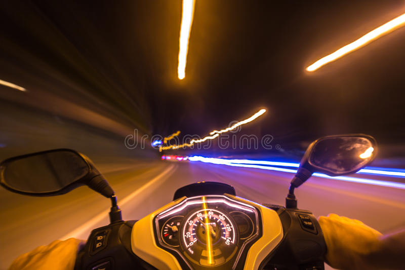 Night motorbike ride. Abstract speed motion background, night city motorbike ride, selective focus on speedometer stock photography
