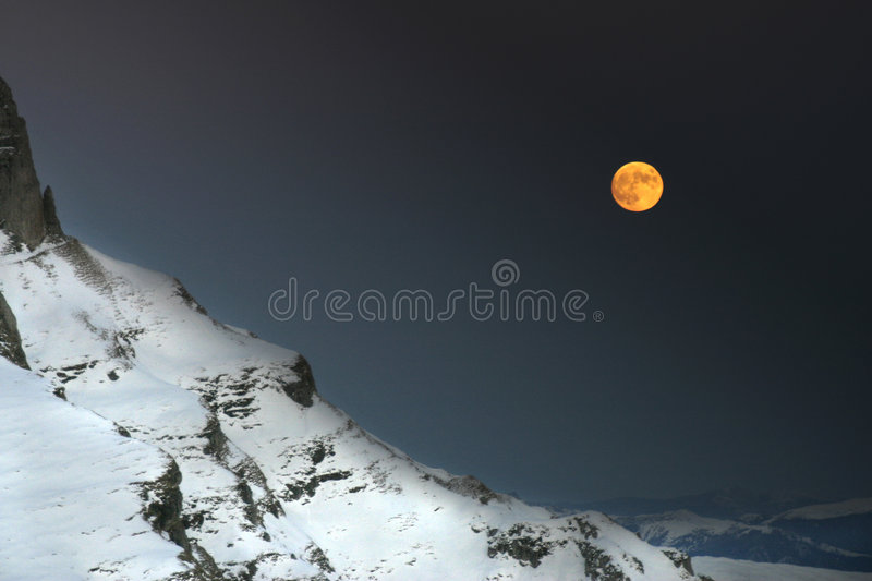 A night in the mountains. Moon rises over Baiului Mountains, Romania stock image
