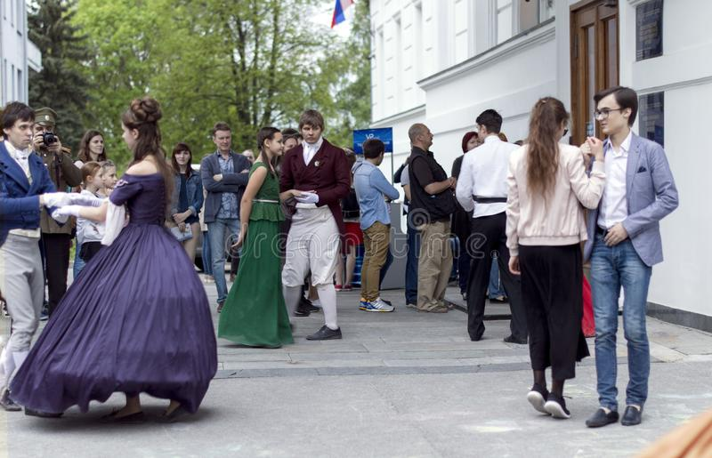 Night of museums festival. Young girl and gentlemen dance padegra in the Russian Museum. royalty free stock photo