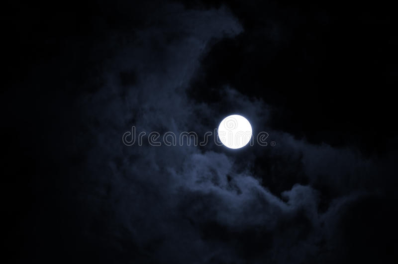Night mysterious landscape in cold tones - full moon in the night sky and dramatic night clouds. royalty free stock photography
