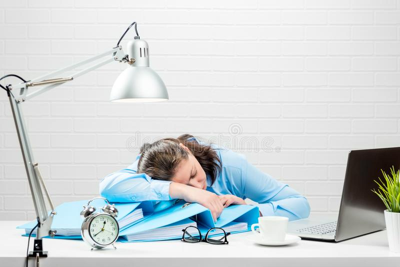 Night overtime accountant, a woman fell asleep stock photography