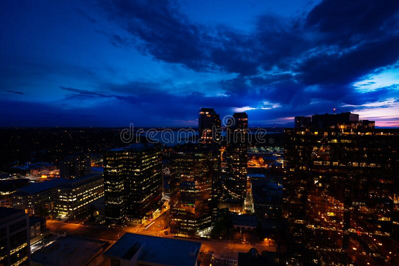 Night panorama of Bellevue city downtown lights. Night panorama of Bellevue city downtown of King County, United States across Lake Washington from Seattle stock images