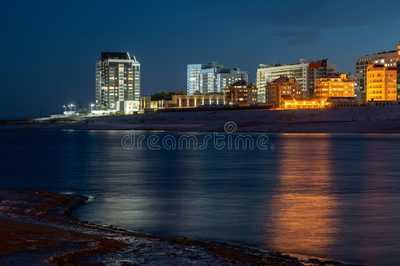 Night panorama of the city with the Lena River, Sakha Republic royalty free stock images