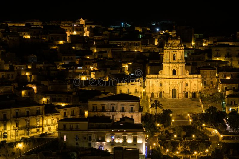A night panorama of Modica, Sicily stock images