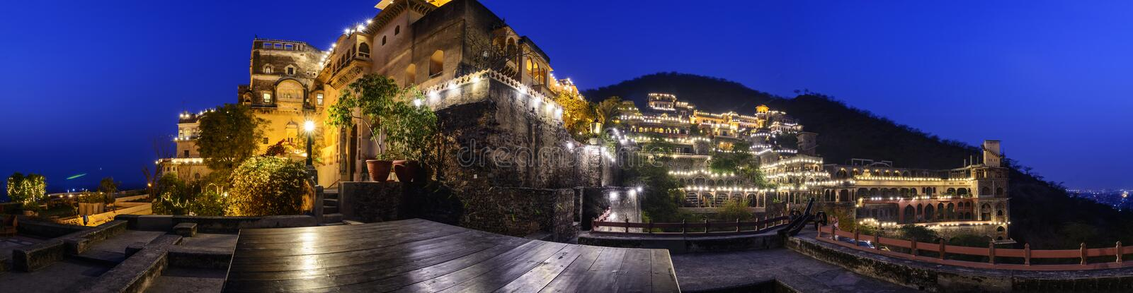 Night Panorama of Neemrana Fort Palace, Rajasthan, India. Old Indian Fort Palace converted into a heritage hotel, Neemrana Fort Palace. The Fort is located at an stock photos
