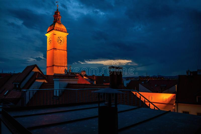 Night panorama of roofs and tower, city Uherske Hradiste. Night panorama of roofs and illuminated old town hall tower in historical city Uherske Hradiste, Czech stock image