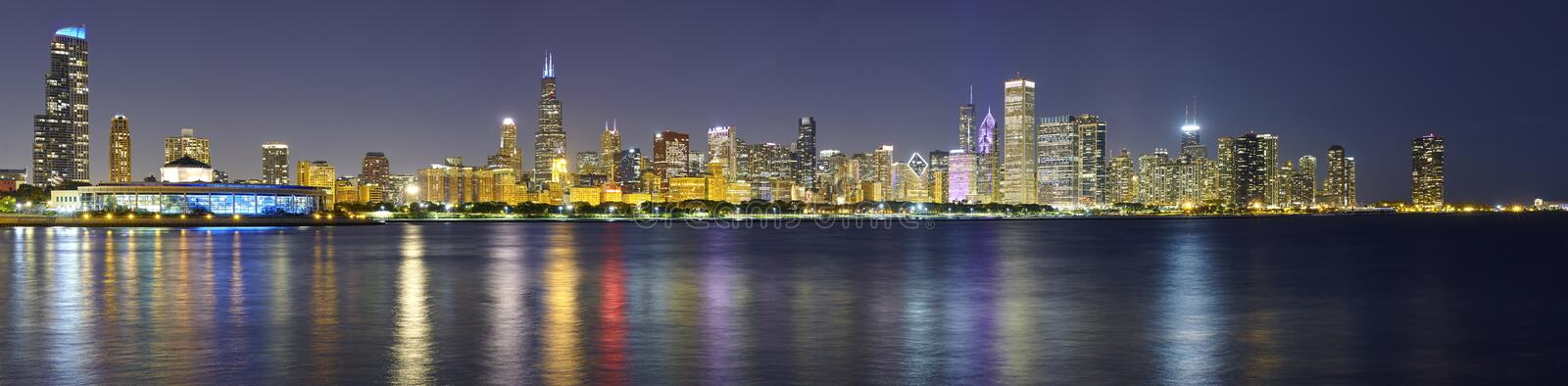 Night panoramic picture of Chicago city skyline with reflection stock image