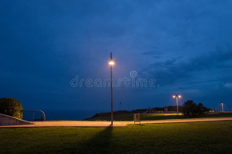 A Night in the Park. Late Autumn Night in the Park. Blue sky and Park Alley. Horizontal Photography stock image