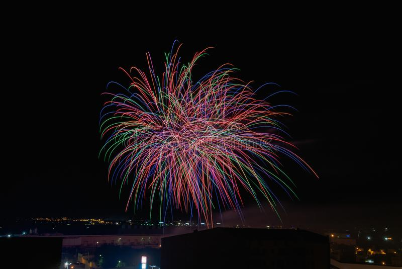 Night party with fireworks with many colors royalty free stock photos