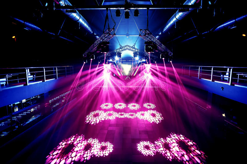 Night party rave concert stage. With pink lasers stock photo