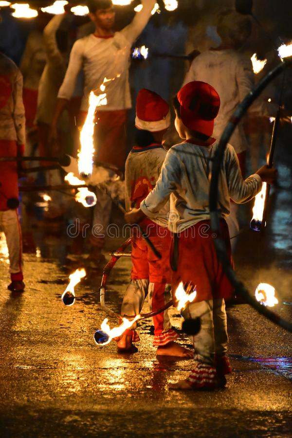 NIGHT PERFORMER WITH FIRE royalty free stock image