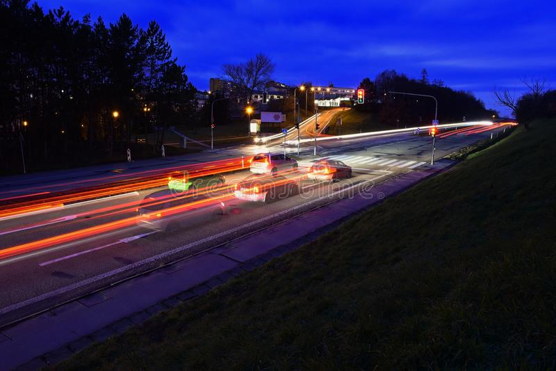 Night photo traffic on the road. Evening landscape with cars. Cars with lights and blurred color lines. Night photo traffic on the road. Evening landscape with royalty free stock photos