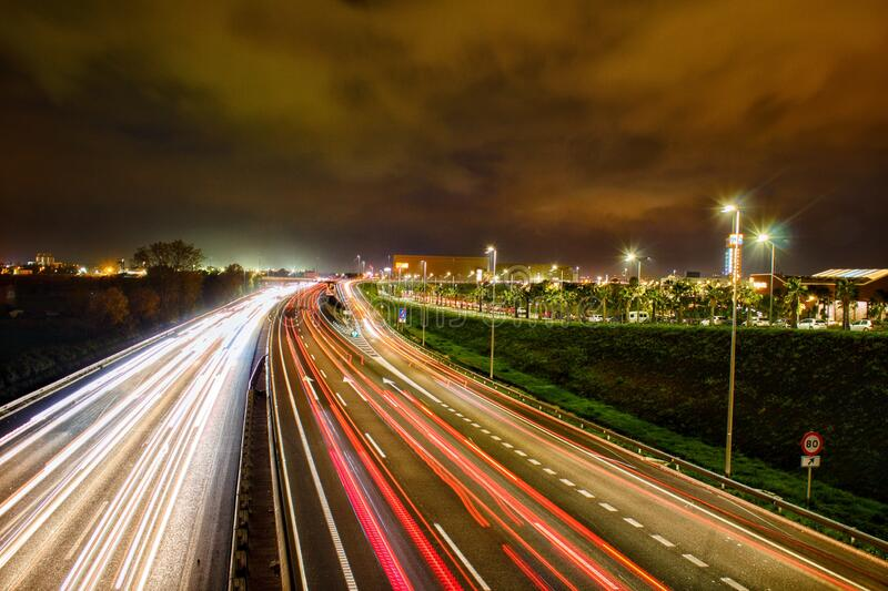 Night photograph of car light trails on a road. stock photography