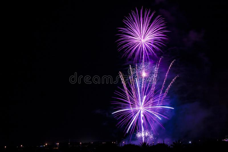 Night picture of a vibrant purple firework stock photos