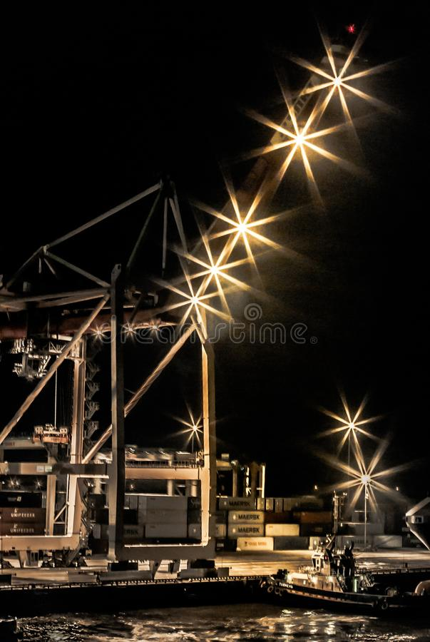Night in port. Ust-Luga container terminal.Container crane. Russia stock photography