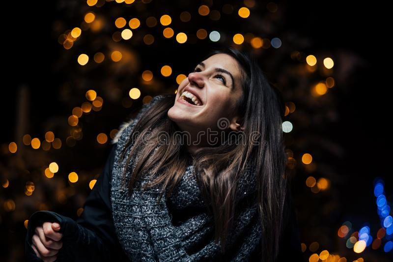 Night portrait of a beautiful brunette woman smiling enjoying winter in park.Winter joy.Winter holidays.Positive emotions. Happiness royalty free stock photos