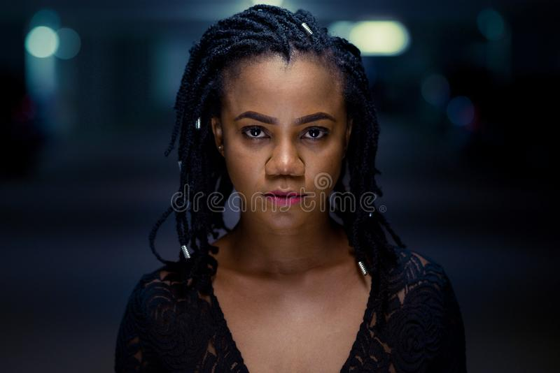 Night portrait of a stylish young African woman stock image