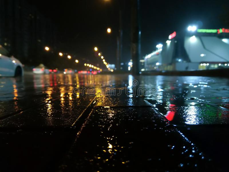 Night rainy city with puddles stock image