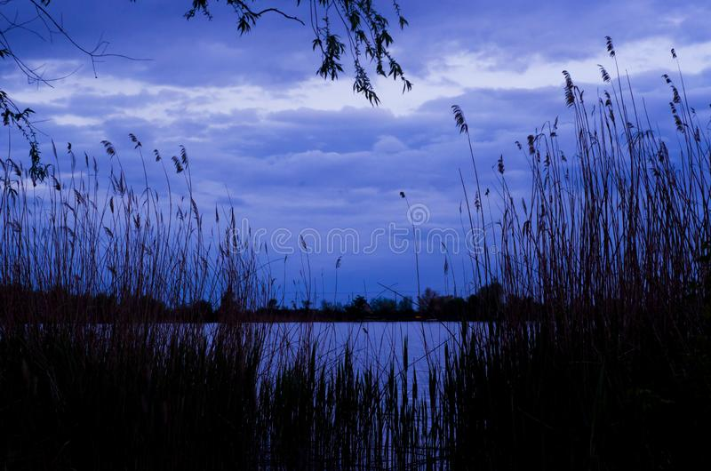 Night river with blue sky and clouds stock image