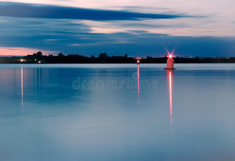 Night river skyline with red lights stock photography