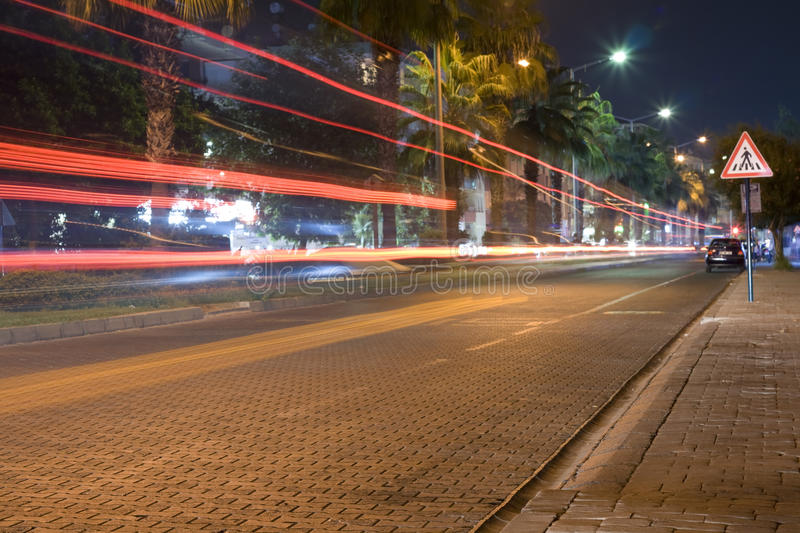 Night road. Traces from headlights of the cars royalty free stock photo