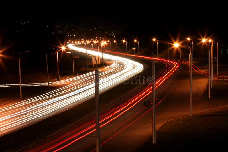 Night road. Light traces on a night city road royalty free stock image