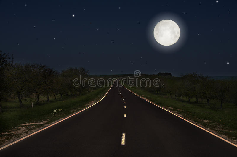Night road. And fuul moon stock photo