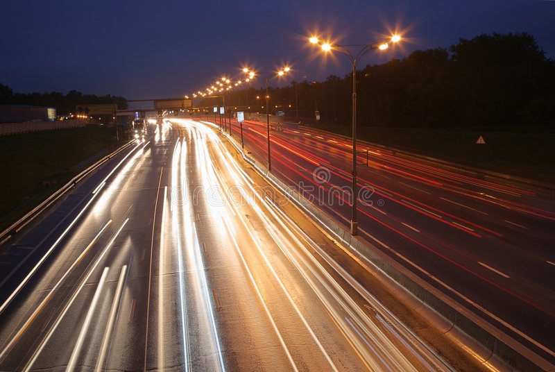 Night road. With car's light stock photography