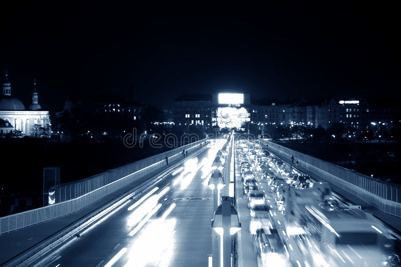 Night road. Traffic at night. Road leads you into the town royalty free stock image