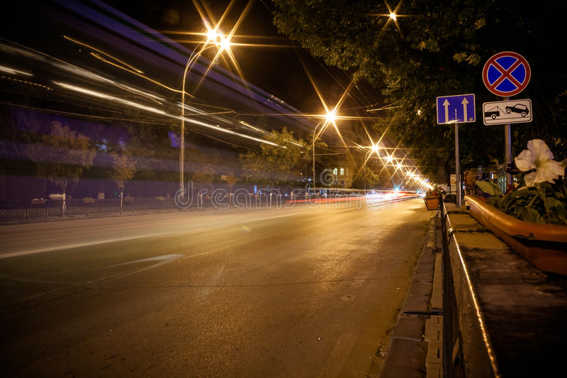 Night road. Night city road with no Parking signs, tow truck work, direction. the summer scene royalty free stock photography