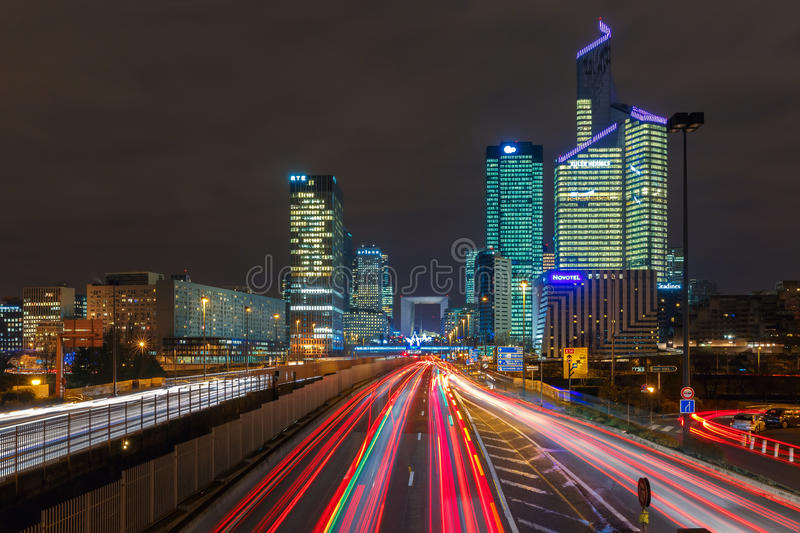 Night road with skyscrapers of La Defense, Paris, France. royalty free stock image