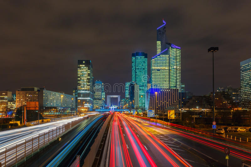 Night road with skyscrapers of La Defense, Paris, France. stock images