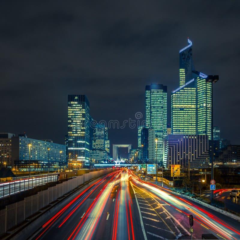 Night road with skyscrapers of La Defense, Paris, France. stock photo