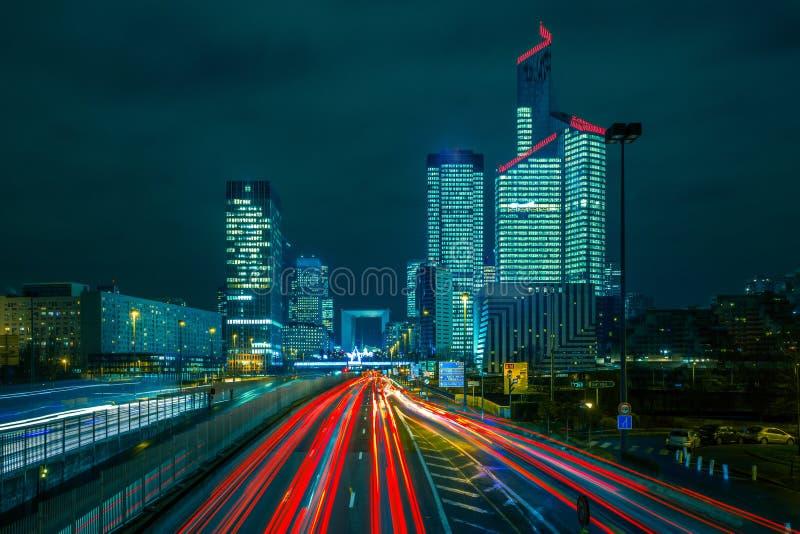 Night road with skyscrapers of La Defense, Paris stock images