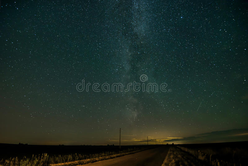 Night road with stars. And the headlights of the car stock images