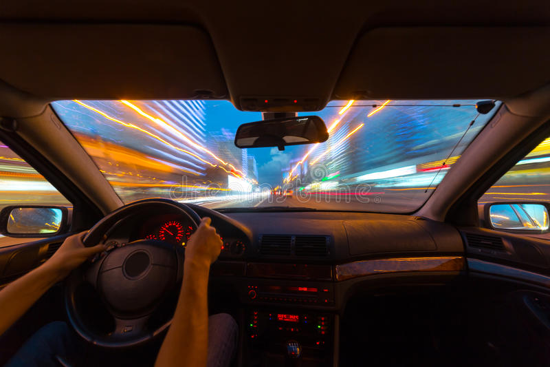 Night road view from inside car. Natural light street and other cars is motion blurred stock photos