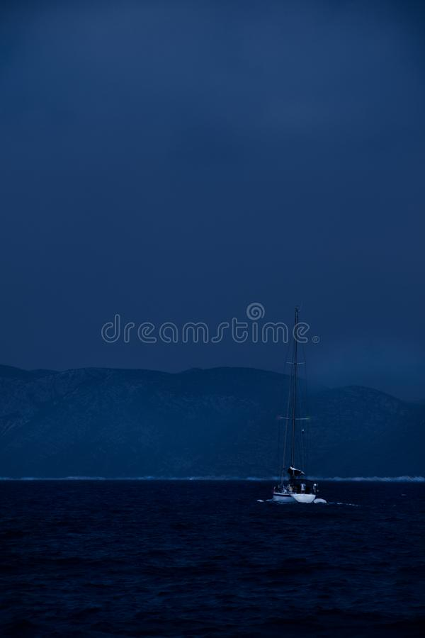 Night sailing to the safety stock image
