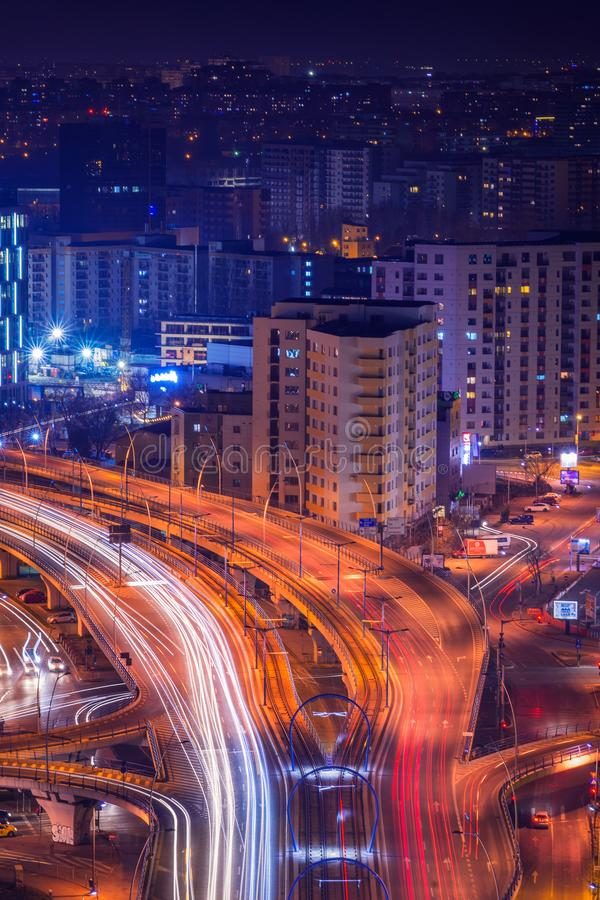 Night scene above the city with city lights and traffic lights a royalty free stock image