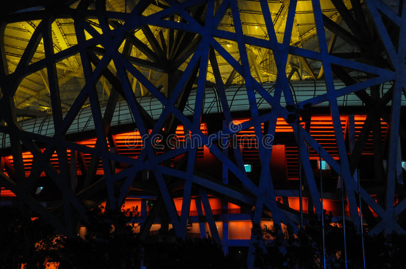Night scene of Beijing National Stadium. LIGHT CONTRAST OF SECONDARY STRUCTURE OF STEEL STRUCTURE The design was awarded to a submission from the Swiss royalty free stock images