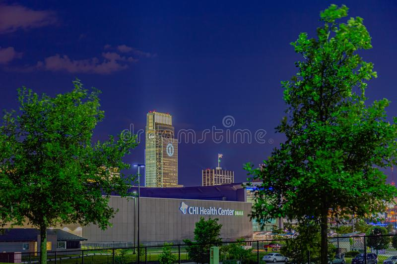 Night scene CHI health center conference center and First National Bank building. Men`s College World Series Omaha Number 1 hologram on FNBO headquarters with royalty free stock images