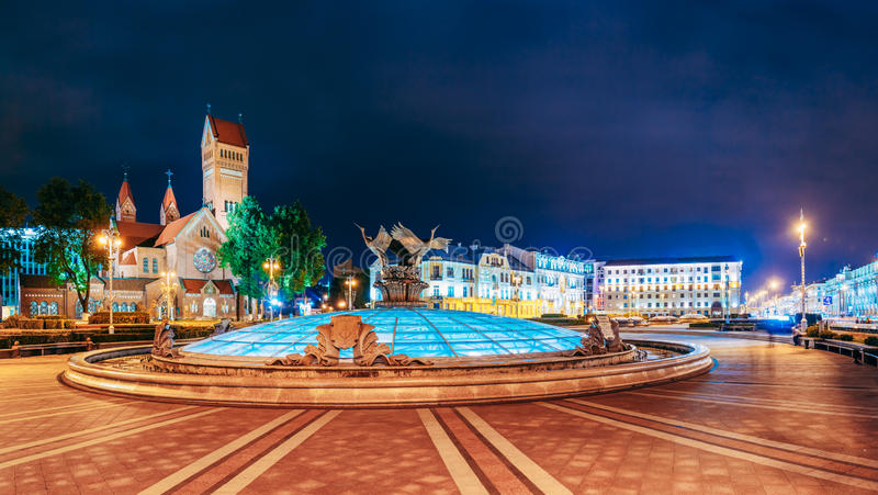 Night Scene - Church Of Saints Simon And Helen Red. Church Is Roman Catholic Church On Independence Square In Minsk, Belarus. Panoramic Shot. This Neo stock image