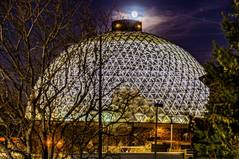 Night scene of the Desert Dome with the moon riding on top at Henry Doorly Zoo Omaha Nebraska. royalty free stock images