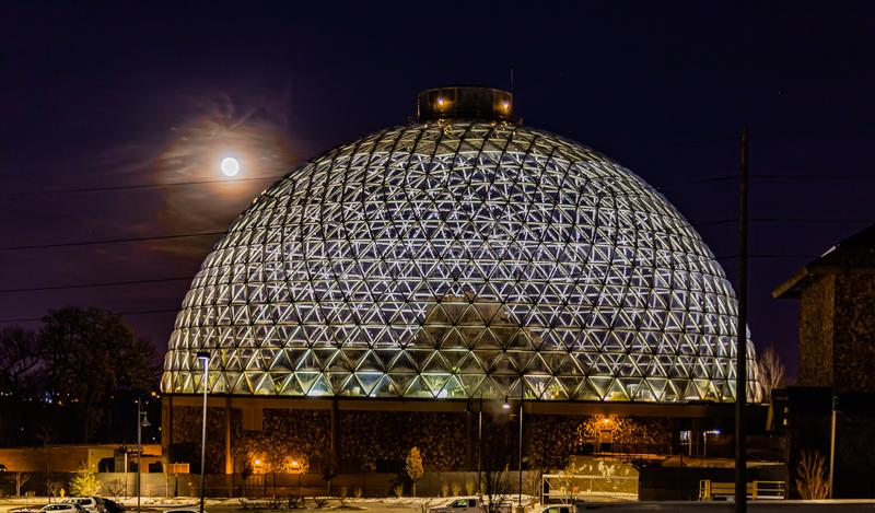 Night scene of the Desert Dome, with the moon riding on the side, at Henry Doorly Zoo Omaha Nebraska. Night scene of the Desert Dome at Henry Doorly Zoo in my royalty free stock image