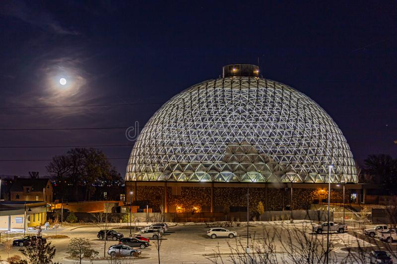 Night scene of the Desert Dome, with the full moon riding on the side, at Henry Doorly Zoo Omaha Nebraska. Night scene of the Desert Dome at Henry Doorly Zoo in stock photography
