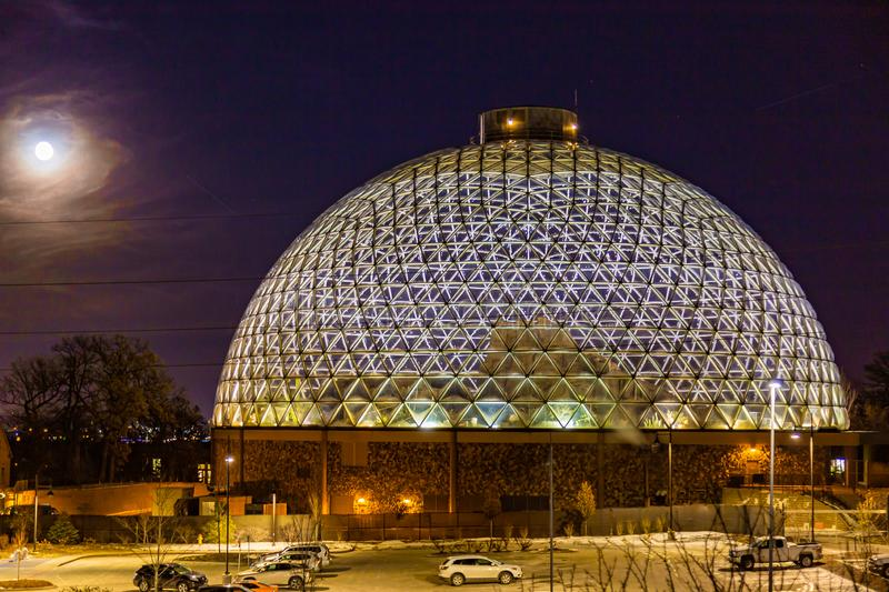 Night scene of the Desert Dome, with the moon riding on the side, at Henry Doorly Zoo Omaha Nebraska. Night scene of the Desert Dome at Henry Doorly Zoo in my royalty free stock photography