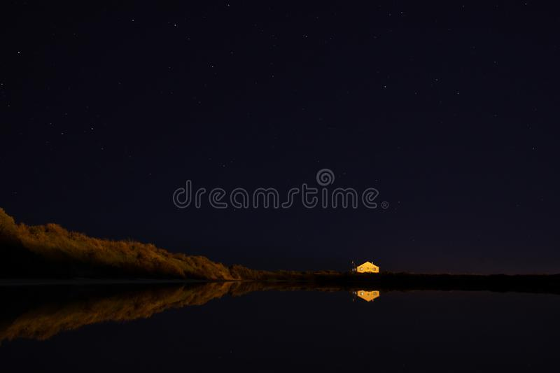 Night scene at Faro Airport with reflections royalty free stock photo