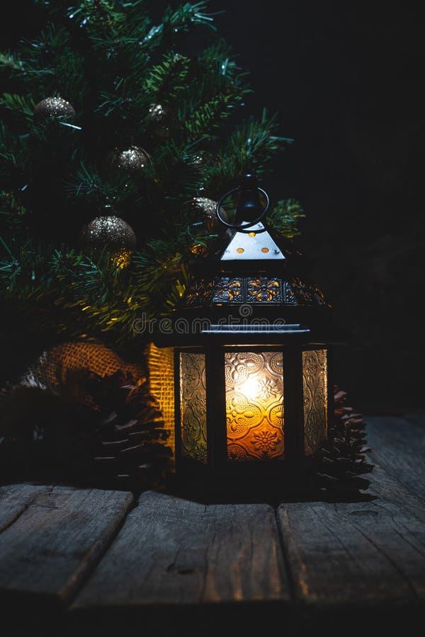 Glowing Lantern and Christmas Tree royalty free stock photos