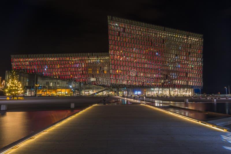 Night scene of Harpa Concert Hall in Reykjavik harbor stock photo