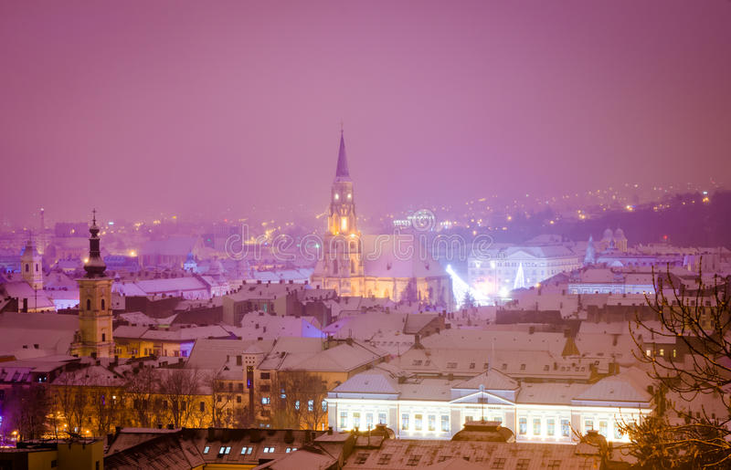 Night scene of historic center of Cluj-Napoca. Old city of Cluj-Napoca night scene during a cold winter with bright lights and a violet blue sky from the stock photo